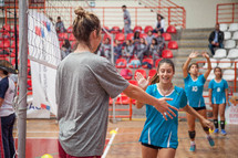 high fives at a volleyball game