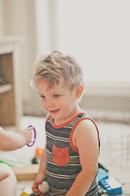 a toddler boy playing with toys