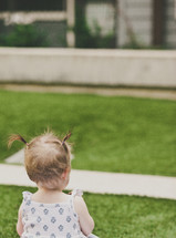 infant girl on a blanket in the grass