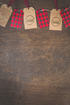 plaid and merry Christmas gift tags on twine