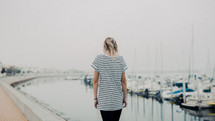 woman walking in a harbor