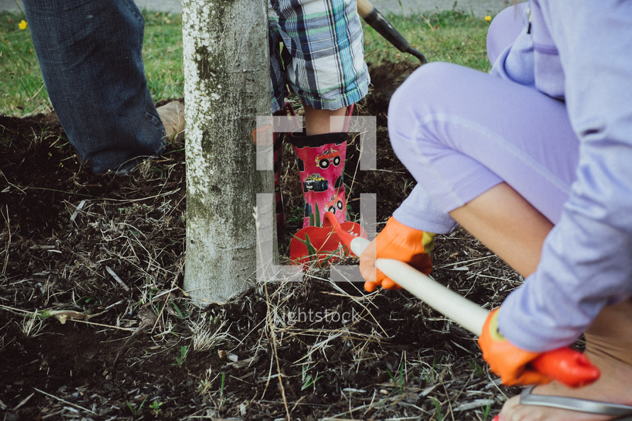 woman gardening with a hoe