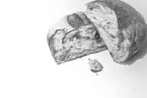 Broken loaf of bread on a white background