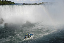 Boat approaching the foot of Niagara Falls waterfall