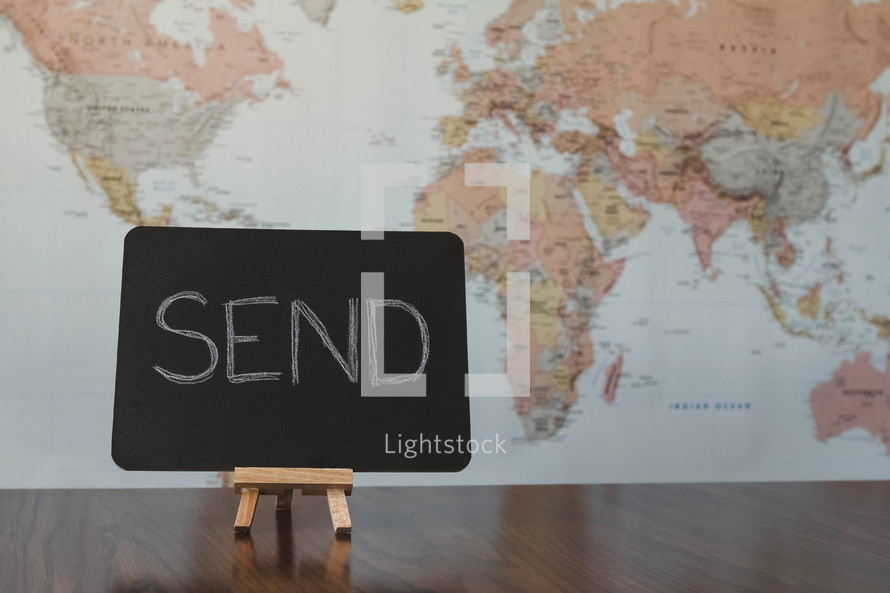 world map and word send on a sign