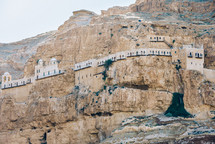 fortress built into a mountain cliff