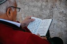 man reading a Hebrew Bible