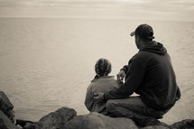 father and daughter at a lake shore