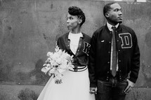 bride and groom in letter jackets