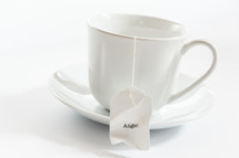 tea cup with tea bag with the word anger