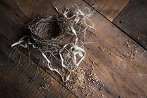 ribbon, bird's nest and bird seed