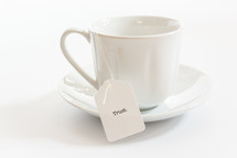 tea cup with the word trust on the tea bag