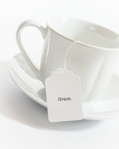 tea cup with the word grace on the tea bag