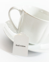 tea cup with the words God's time on the tea bag