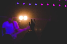 raised hand at a concert