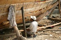 a man building a boat in Yemen