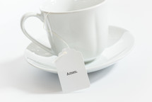 tea cup with the word Amen on the tea bag