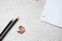 pencil shavings, pencil, notebook paper