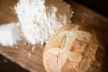 bread and flour on a cutting board