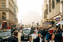 crowds of people and taxis on the streets of London