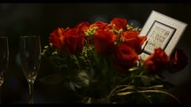 champagne glasses and red roses
