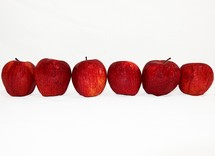 Row of red apples.