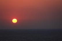 Red sunrise over the ocean.