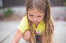 A young girl plays outside.