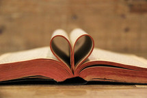 pages of a Bible folded into the shape of a heart