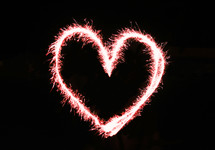 Heart shape drawn with fireworks