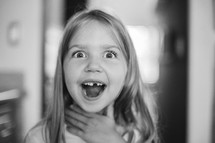 Little girl with a surprised look on her face.