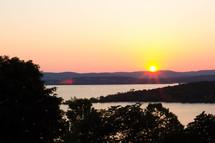 horizon at sunset over a lake