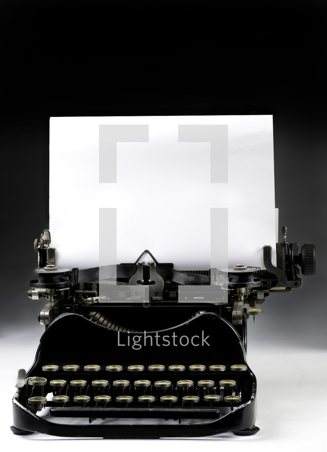 typewriter with blank paper
