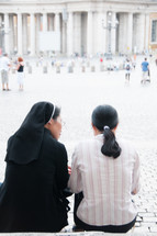 a nun talking to a young woman