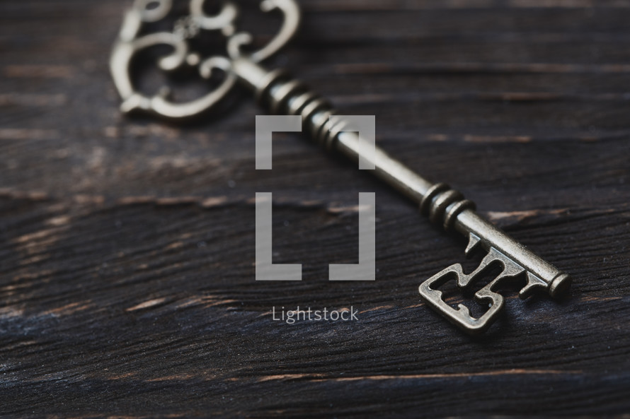 skeleton key on wood background