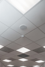 speaker and smoke alarm in a ceiling