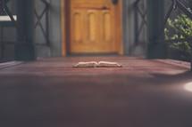 open Bible in a doorway