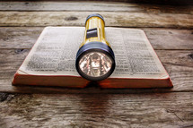 flashlight on a Bible