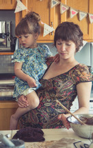 mother and daughter together in a kitchen