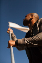 Man carrying white flag.