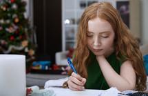 girl doing homework at Christmas