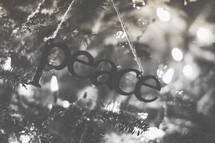 A peace ornament on the Christmas tree
