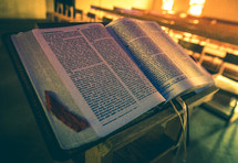 open Bible at the pulpit