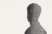 silhouette of a man in newspaper print