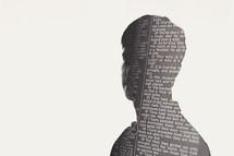 silhouette of a man in newspaper print