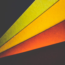 yellow, red, orange, black papers
