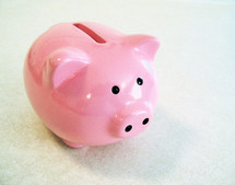 A pink piggy bank for coins and money to start saving for a rainy day whether it be college, education, a new home or major purchase.
