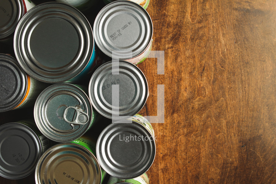 Canned food sitting on a wood table