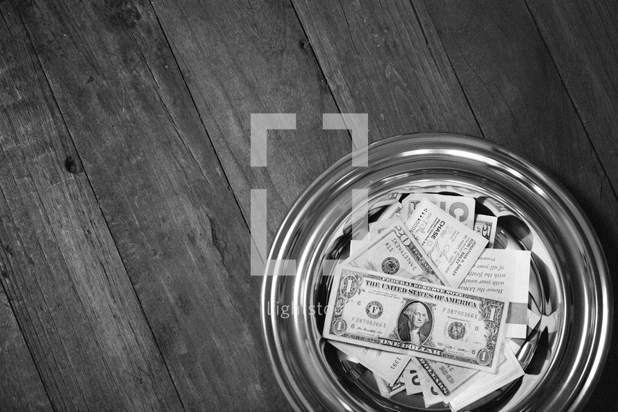 Tithes and offerings resting inside an offering bucket