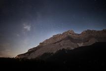 mountain peak under a starry night